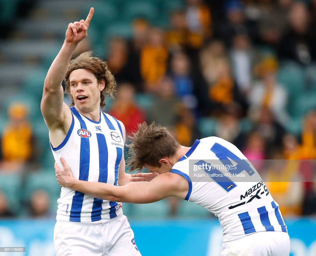 Ben Brown of the Kangaroos celebrates a goal with Trent Dumont of the Kangaroos (right) during the 2017 AFL round 21 match between the Hawthorn Hawks and the North Melbourne Kangaroos at the University of Tasmania Stadium on August 13, 2017 in Launceston, Australia.