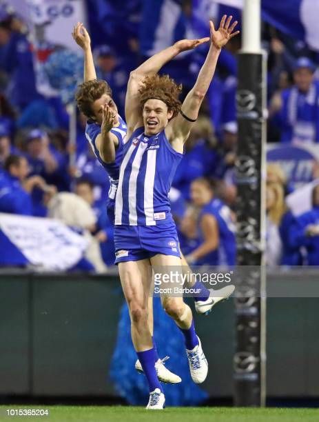 Ben Brown of the Kangaroos celebrates after kicking a goal with Will Walker of the Kangaroos during the round 21 AFL match between the North...