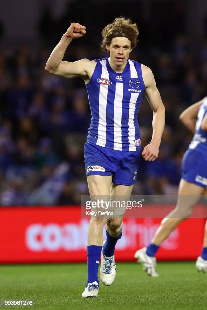 Ben Brown of the Kangaroos celebrates his goal during the round 16 AFL match between the North Melbourne Kangaroos and the Gold Coast Suns at Etihad...