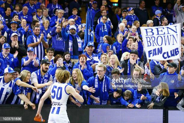 Ben Brown of the Kangaroos celebrates the win with fans during the round 23 AFL match between the St Kilda Saints and the North Melbourne Kangaroos...