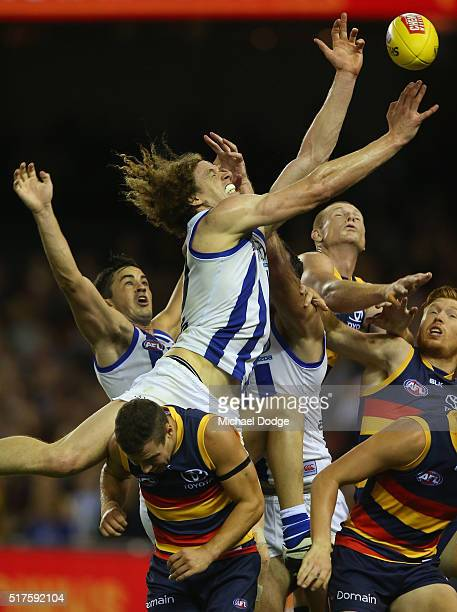 Ben Brown of the Kangaroos competes for the ball in a large pack of players during the round one AFL match between the North Melbourne Kangaroos and...