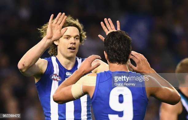 Ben Brown of the Kangaroos is congratulated by Luke DaviesUniacke after kicking a goal during the round six AFL match between the North Melbourne...