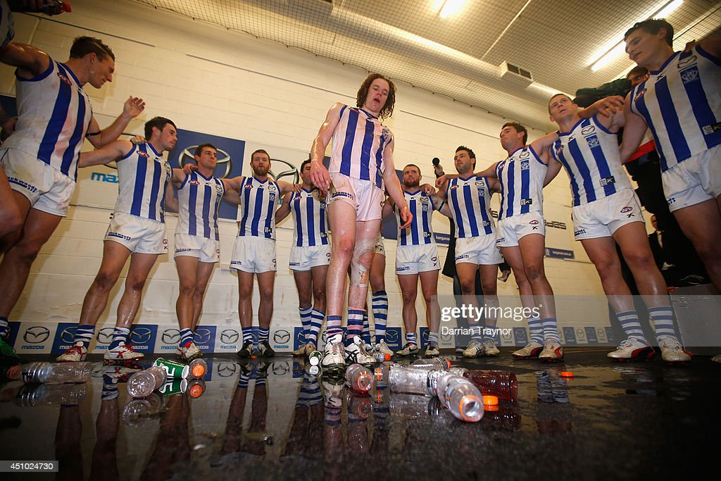 Ben Brown of the Kangaroos is showered by team mates after the round 14 AFL match between the Melbourne Demons and the North Melbourne Kangaroos at Melbourne Cricket Ground on June 22, 2014 in Melbourne, Australia.