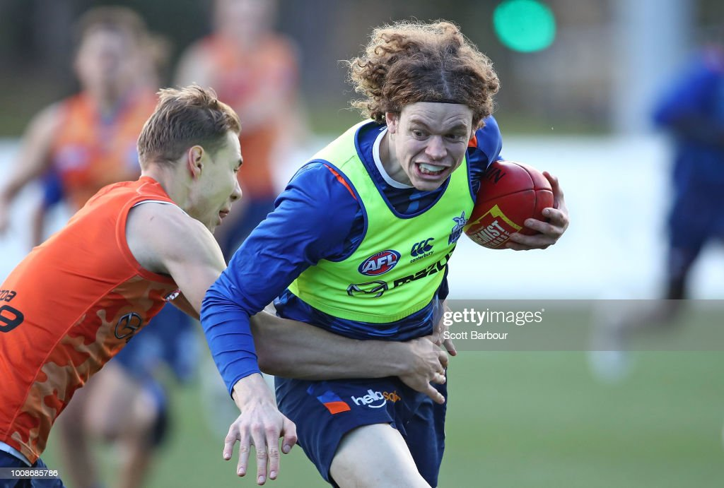 Ben Brown of the Kangaroos is tackled by Ben McKay of the Kangaroos during an North Melbourne Kangaroos AFL training session at Arden Street Ground on August 1, 2018 in Melbourne, Australia.