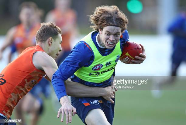 Ben Brown of the Kangaroos is tackled by Ben McKay of the Kangaroos during an North Melbourne Kangaroos AFL training session at Arden Street Ground...