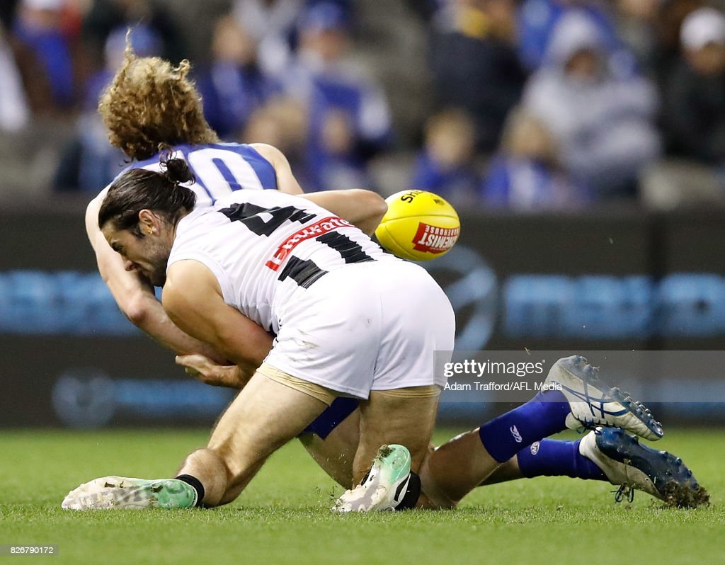 Ben Brown of the Kangaroos is tackled by Brodie Grundy of the Magpies during the 2017 AFL round 20 match between the North Melbourne Kangaroos and the Collingwood Magpies at Etihad Stadium on August 05, 2017 in Melbourne, Australia.