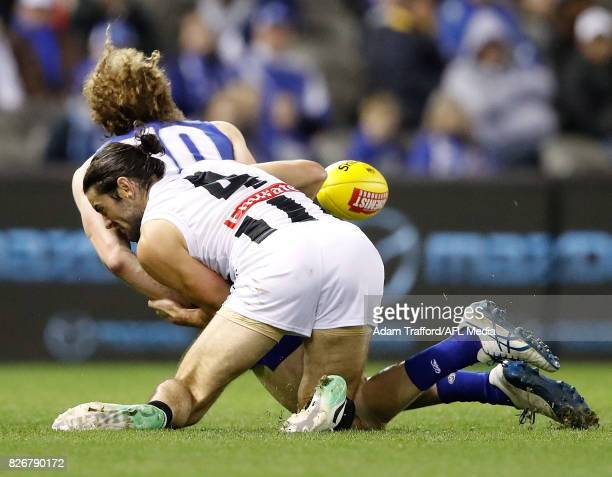 Ben Brown of the Kangaroos is tackled by Brodie Grundy of the Magpies during the 2017 AFL round 20 match between the North Melbourne Kangaroos and...
