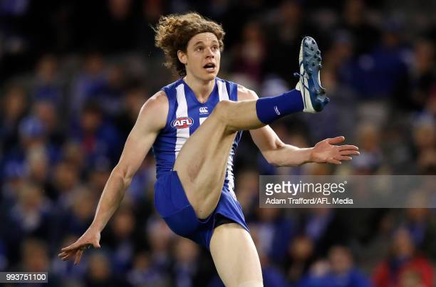Ben Brown of the Kangaroos kicks the ball during the 2018 AFL round 16 match between the North Melbourne Kangaroos and the Gold Coast Suns at Etihad...