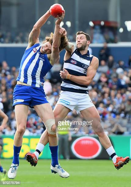 Ben Brown of the Kangaroos marks infront of Sam Menegola of the Cats during the round 12 AFL match between the Geelong Cats and the North Melbourne...