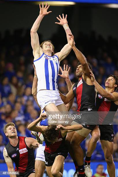 Ben Brown of the Kangaroos marks over the top of Jason Ashby of the Bombers during the round 16 AFL match between the North Melbourne Kangaroos and...
