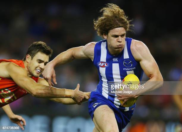 Ben Brown of the Kangaroos runs with the ball from Jack Leslie of the Suns during the round six AFL match between the North Melbourne Kangaroos and...