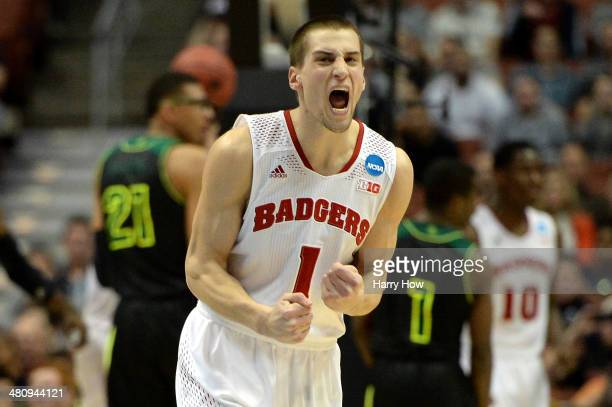 Ben Brust of the Wisconsin Badgers celebrates in the first half while taking on the Baylor Bears during the regional semifinal of the 2014 NCAA Men's...