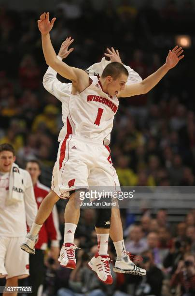 Ben Brust of the Wisconsin Badgers celebrates with a teammate near the end of a game against the Michigan Wolverines during a quarterfinal game of...