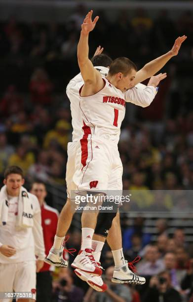 Ben Brust of the Wisconsin Badgers celebrates with teammates near the end of a game against the Michigan Wolverines during a quarterfinal game of the...