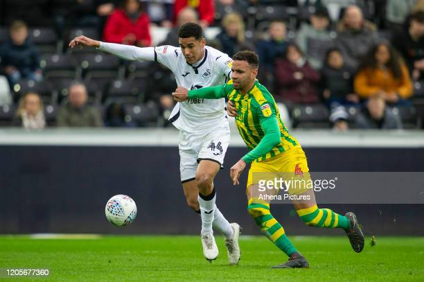 Ben Cabango of Swansea City battles with Hal RobsonKanu of West Bromwich Albion during the Sky Bet Championship match between Swansea City and West...