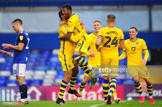 Ben Cabango of Swansea City celebrates scoring his side's second goal with team mate Rhian Brewster during the Sky Bet Championship match between...