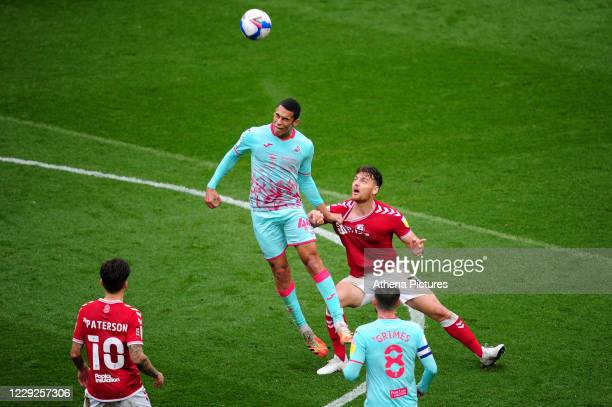Ben Cabango of Swansea City vies for possession with Chris Martin of Bristol City during the Sky Bet Championship match between Bristol City and...