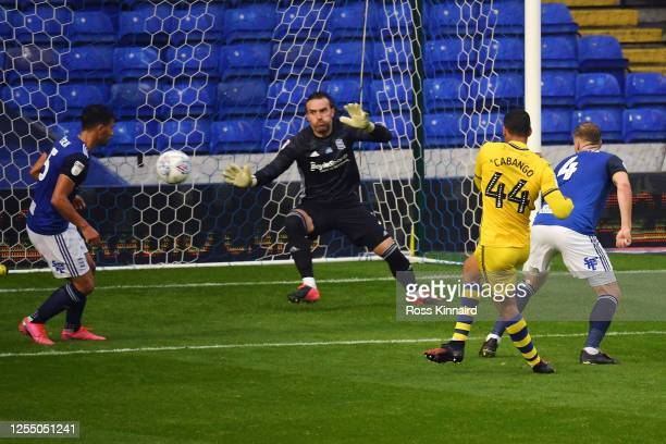 Ben Cabango of Swansea scores his team's second goal against goalkeeper Lee Camp of Birmingham during the Sky Bet Championship match between...