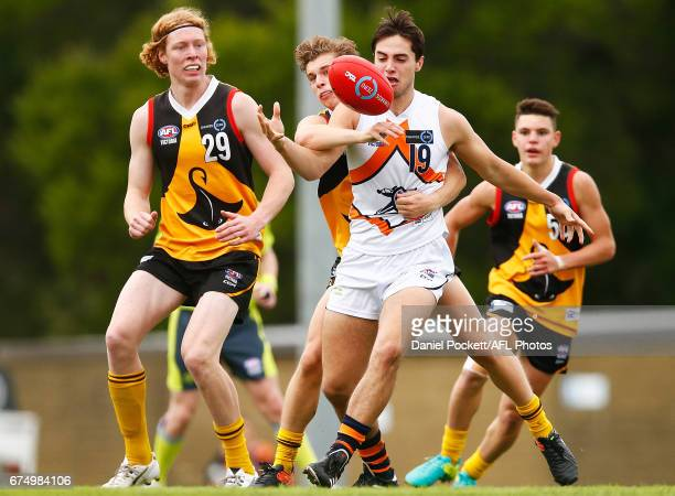 Ben Caluzzi of the Cannons is tackled by Dylan Morris of the Stingrays during the round five TAC Cup match between Dandenong and Calder at Shepley...