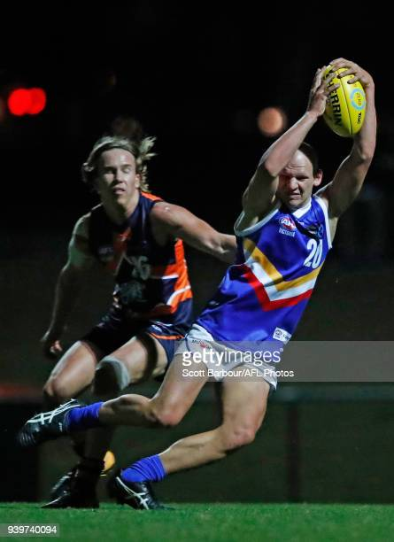 Ben Cardamone of the Eastern Ranges runs with the ball during the round two TAC Cup match between Calder and Eastern Ranges at RAMS Arena on March 29...
