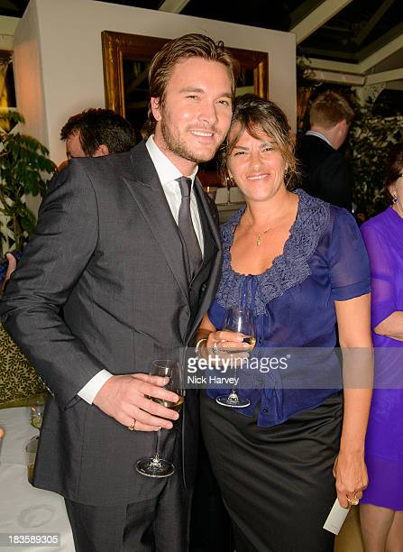Ben Caring and Tracey Emin attend Nicola and James Stephenson Tracey Emin and Johnny Bergius VIP Party at Mark's Club on October 7 2013 in London...