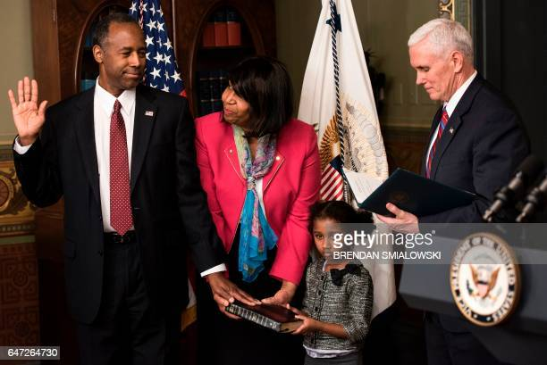 Ben Carson is sworn in as US Secretary of Housing and Urban Development by US Vice President Mike Pence as his wife Candy Carson and granddaughter...