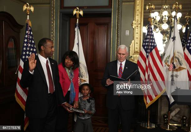 Ben Carson participates in a swearingin ceremony officiated by Vice President Mike Pence as his wife Candy Carson and fiveyearold granddaughter...