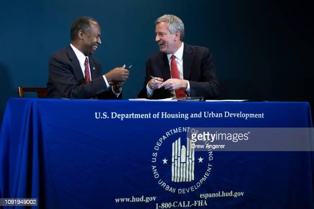 Ben Carson, Secretary of Housing and Urban Development , and New York City Mayor Bill de Blasio sign a ceremonial agreement between the federal...