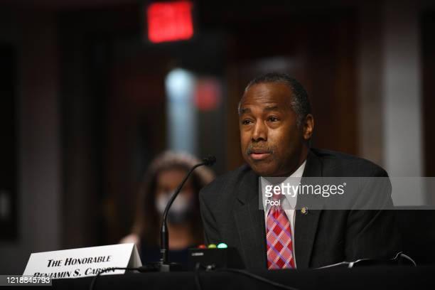 Ben Carson, U.S. Secretary of the U.S. Department of Housing and Urban Development, answers questions before the U.S. Senate Committee on Banking,...
