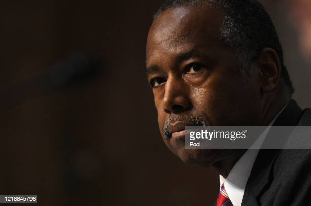 Ben Carson, U.S. Secretary of the U.S. Department of Housing and Urban Development, listens to questions during testimony before the U.S. Senate...