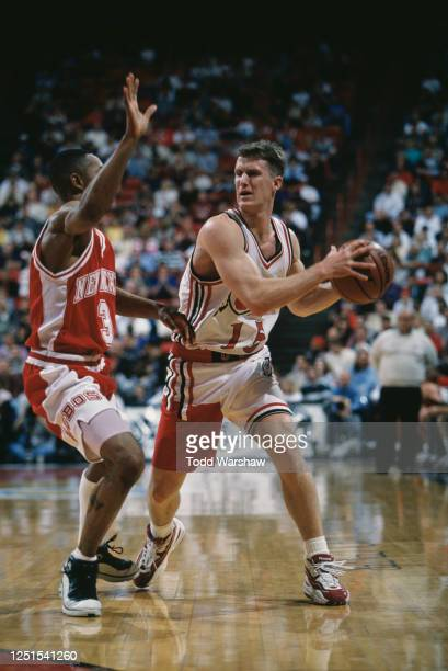 Ben Caton, Guard for the University of Utah Utes and Lamont Long, Guard for the University of New Mexico Lobos during their NCAA Western Athletic...
