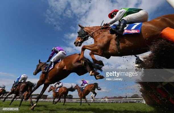 Ben Cee Pee M ridden by Craig Gallagher clears a fence during The £3 Million totescoop6 Today Handicap Hurdle Race at Haydock Racecourse on April 19...