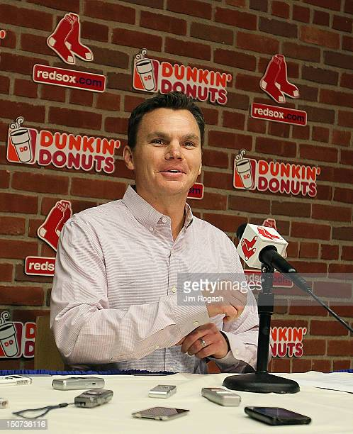 Ben Cherington general manager of the Boston Red Sox smiles as he announces a trade between the Boston Red Sox and the Los Angeles Dodgers during a...