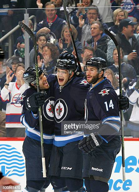 Ben Chiarot Adam Lowry and Anthony Peluso of the Winnipeg Jets celebrate Lowry's first period goal against the Columbus Blue Jackets at the MTS...