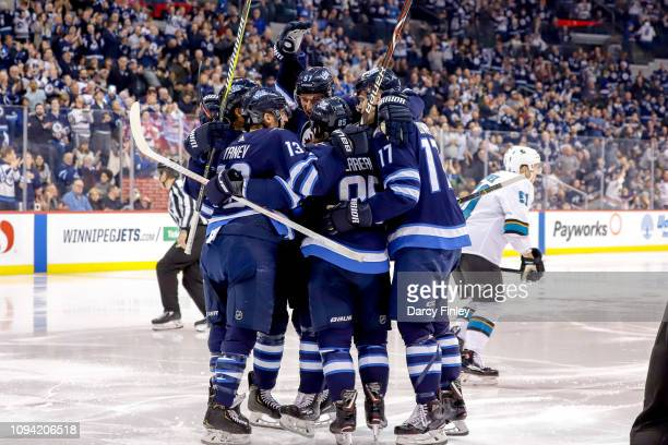 Ben Chiarot Brandon Tanev Tyler Myers Mathieu Perreault and Adam Lowry of the Winnipeg Jets celebrate a second period goal against the San Jose...