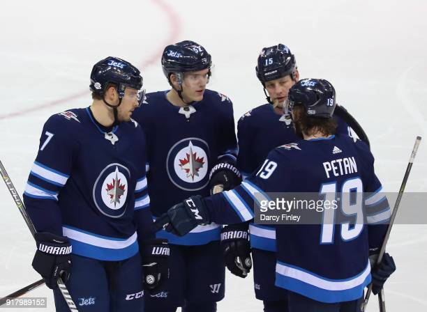 Ben Chiarot Jack Roslovic Matt Hendricks and Nic Petan of the Winnipeg Jets discuss strategy during a first period stoppage in play against the...