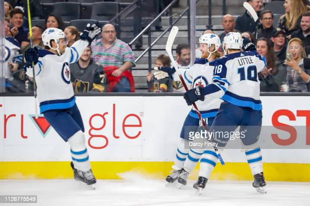 Ben Chiarot Kyle Connor and Bryan Little of the Winnipeg Jets celebrate a first period goal against the Vegas Golden Knights at TMobile Arena on...