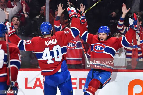 Ben Chiarot of the Montreal Canadiens celebrates his game winning goal in overtime with teammate Joel Armia against the Ottawa Senators at the Bell...