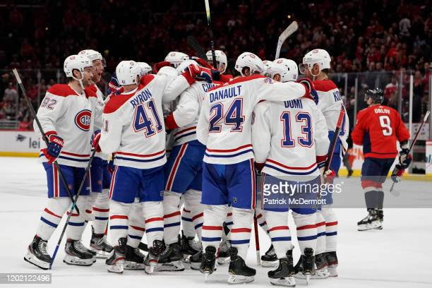 Ben Chiarot of the Montreal Canadiens celebrates with his teammates after scoring the game winning goal against the Washington Capitals in overtime...