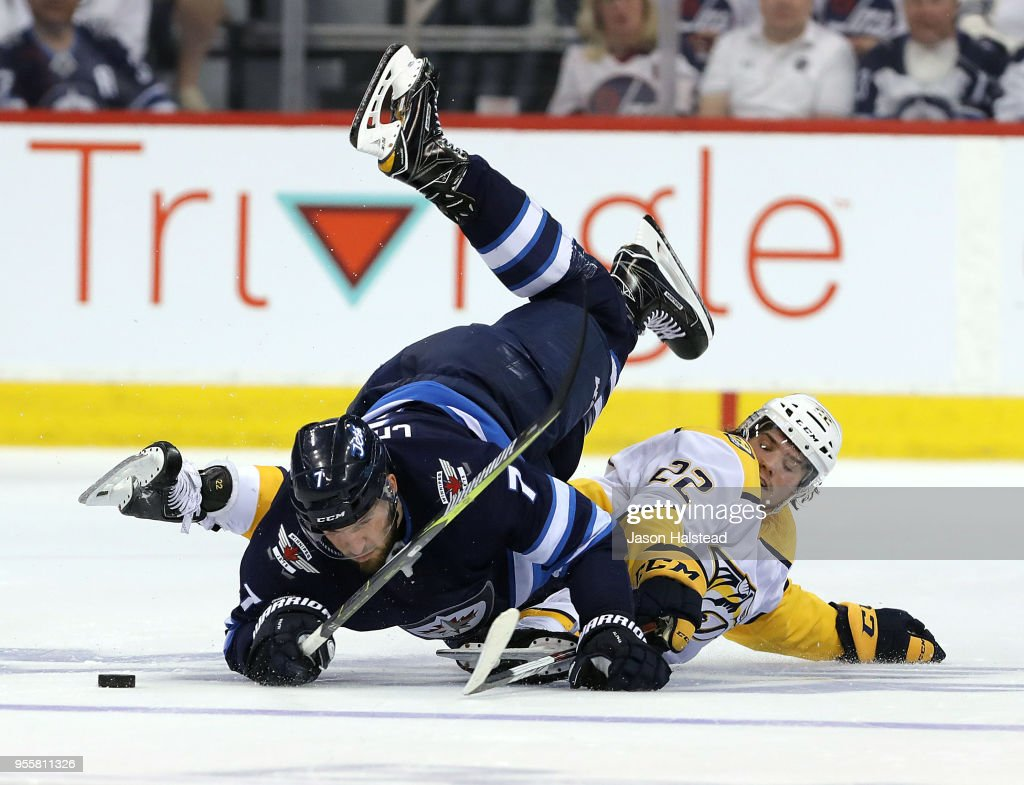 Ben Chiarot #7 of the Winnipeg Jets collides with Kevin Fiala #22 of the Nashville Predators in Game Six of the Western Conference Second Round during the 2018 NHL Stanley Cup Playoffs on May 7, 2018 at Bell MTS Place in Winnipeg, Manitoba, Canada.