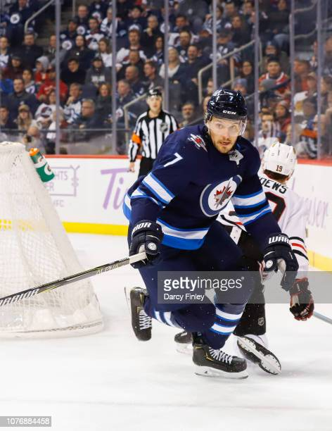 Ben Chiarot of the Winnipeg Jets follows the play around the boards during third period action against the Chicago Blackhawks at the Bell MTS Place...