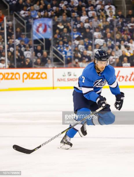 Ben Chiarot of the Winnipeg Jets follows the play down the ice during second period action against the Pittsburgh Penguins at the Bell MTS Place on...