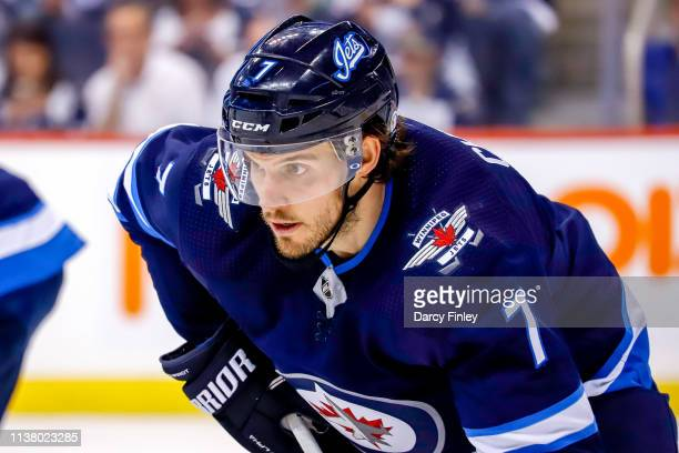 Ben Chiarot of the Winnipeg Jets gets set during a second period faceoff against the St Louis Blues in Game Five of the Western Conference First...