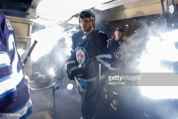 Ben Chiarot of the Winnipeg Jets heads to the ice prior to puck drop against the St Louis Blues in Game Five of the Western Conference First Round...