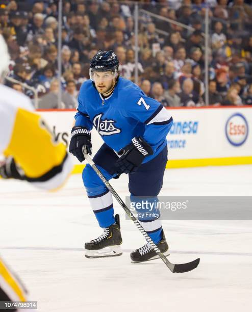 Ben Chiarot of the Winnipeg Jets keeps an eye on the play during second period action against the Pittsburgh Penguins at the Bell MTS Place on...