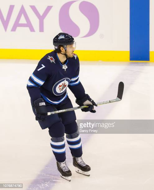 Ben Chiarot of the Winnipeg Jets keeps an eye on the play during second period action against the Chicago Blackhawks at the Bell MTS Place on...
