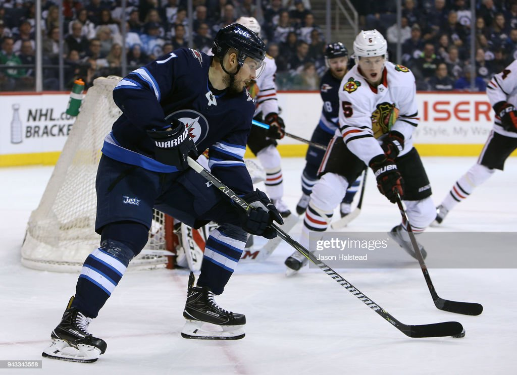 Ben Chiarot #7 of the Winnipeg Jets looks to pass as Connor Murphy #5 of the Chicago Blackhawks defends during NHL action on April 7, 2018 at Bell MTS Place in Winnipeg, Manitoba.