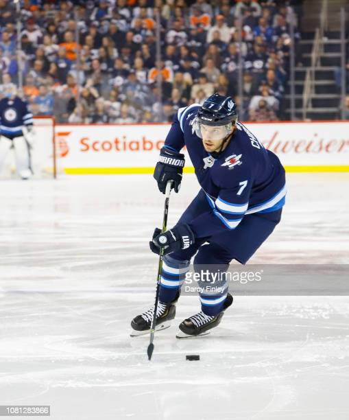 Ben Chiarot of the Winnipeg Jets okays the puck down the ice during second period action against the Philadelphia Flyers at the Bell MTS Place on...