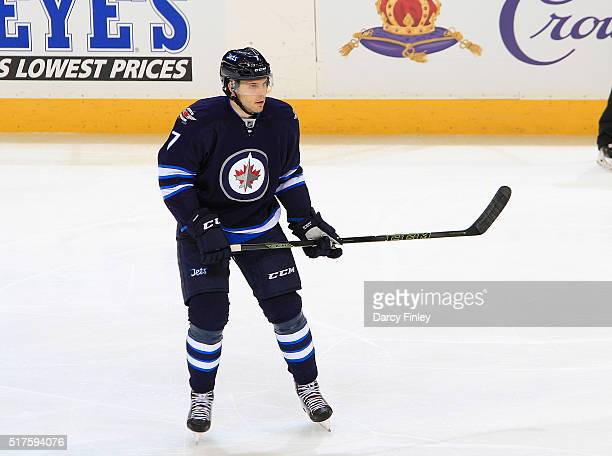 Ben Chiarot of the Winnipeg Jets plays the puck down the ice during second period action against the Chicago Blackhawks at the MTS Centre on March 18...