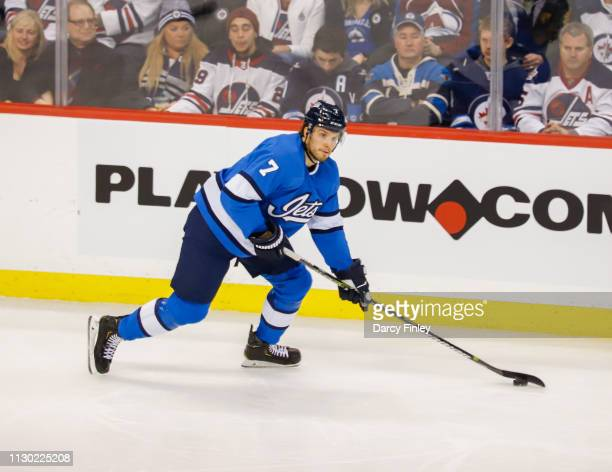 Ben Chiarot of the Winnipeg Jets plays the puck up the ice during second period action against the Colorado Avalanche at the Bell MTS Place on...
